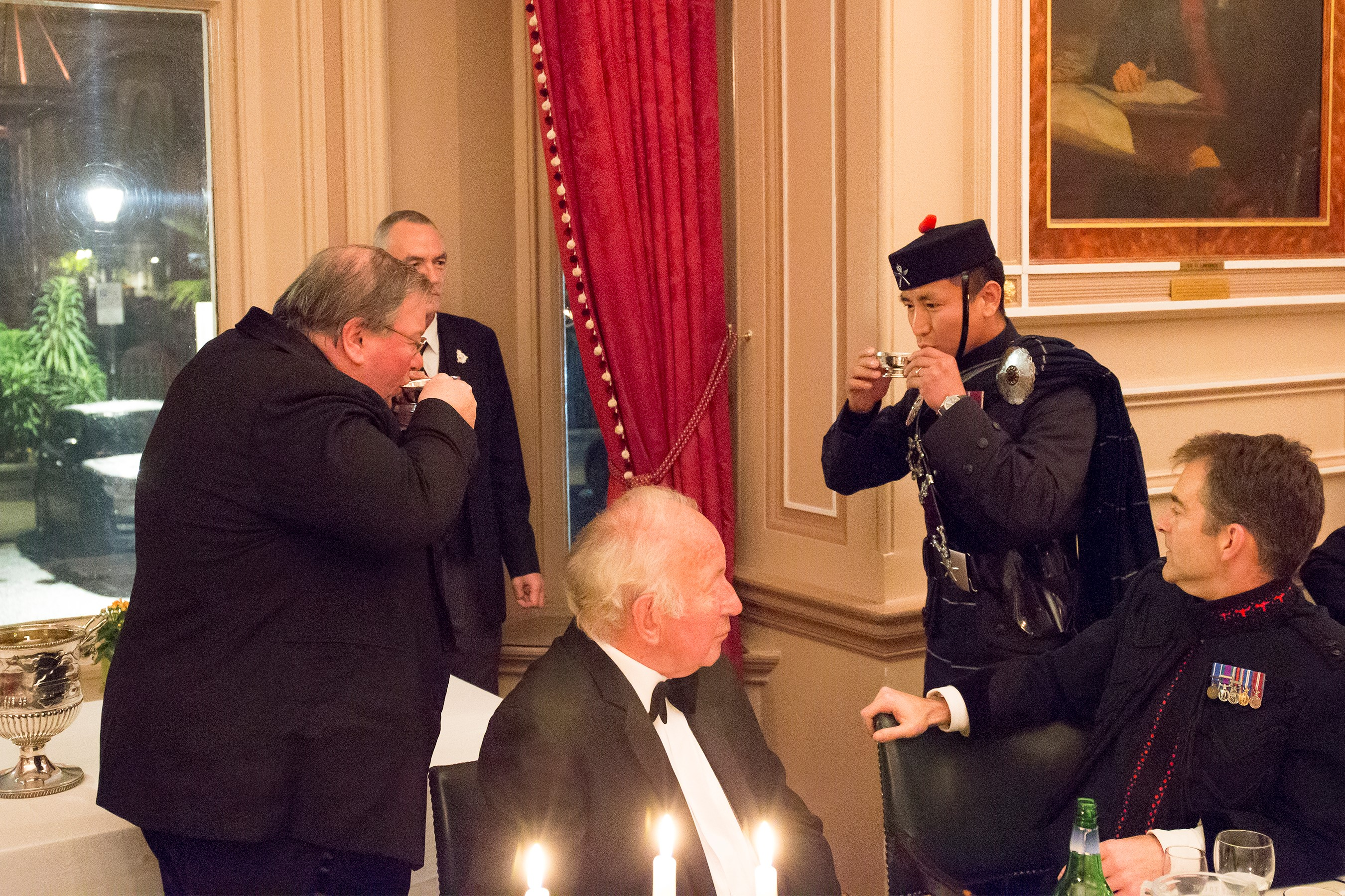 "Pipe Major 2 RGR sharing a ""wee dram"" with the chairman of the East India Club"