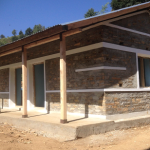 Queen's Gurkha Engineer built house ready for window and door installation