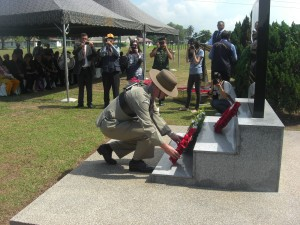 Col James Robinson lays a wreath on behalf of the Brigade of Gurkhas at Tambun Road, Ipoh