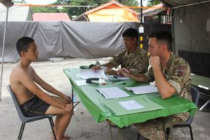 A Potential Recruit being interviewed by Gurkha Officers during Regional Selection