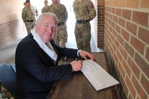 Minister Armed Forces signing visitors book
