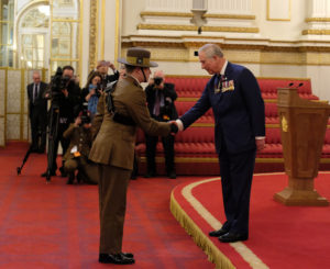 Lt Barney congratulated by Prince Charles