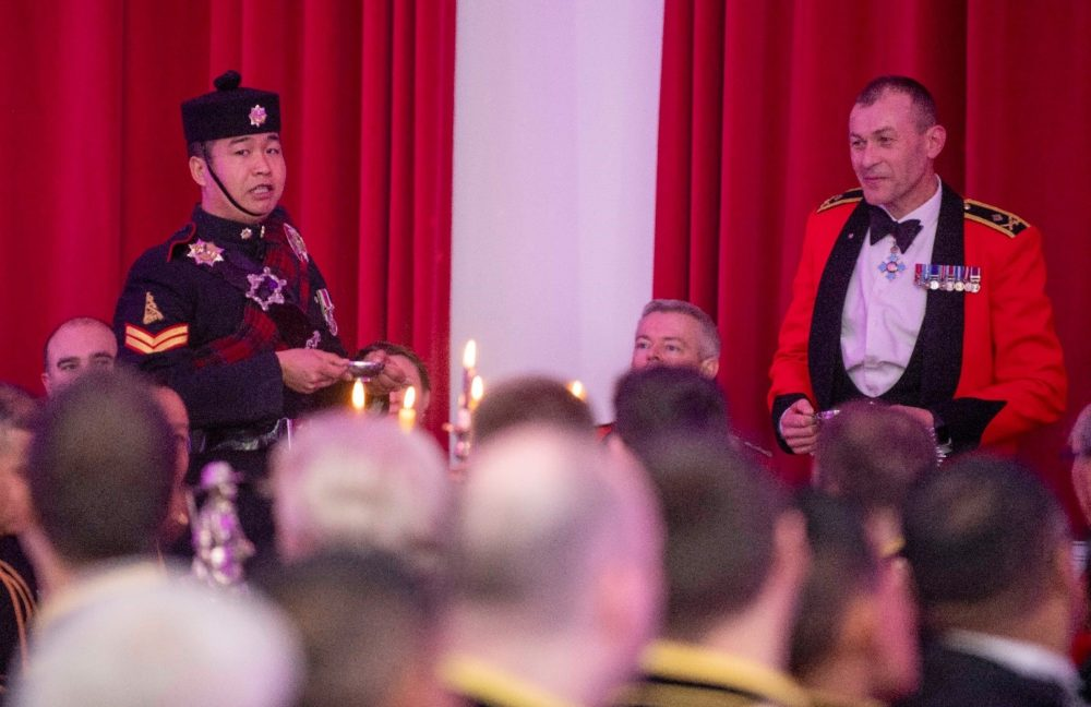 Maj Gen Capps and Cpl Lokraj Limbu toast the evening following a display by the 10 QOGLR Pipes and Drums.